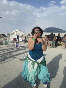 me enjoying shave ice on the playa