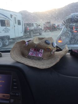 Julia's hat on the dash as we waited in the Exodus line