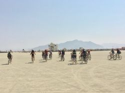 Pinkies biking across the playa